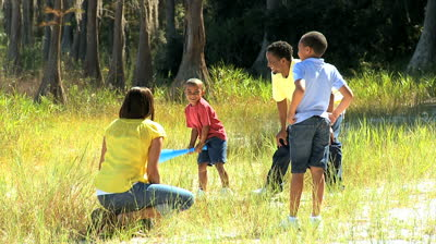 stock-footage-active-young-african-american-family-having-fun-playing-baseball-together-in-the-park